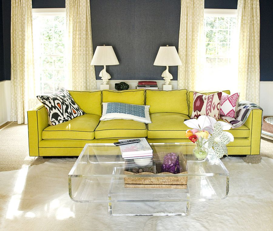 Cozy yellow couch and acrylic coffee table enliven the living space [From: Luck Stone Center]