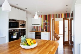 Creative and colorful striped accent wall for a crisp modern kitchen