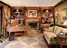 Custom-built bookcases surround the fireplace in this beautiful home office