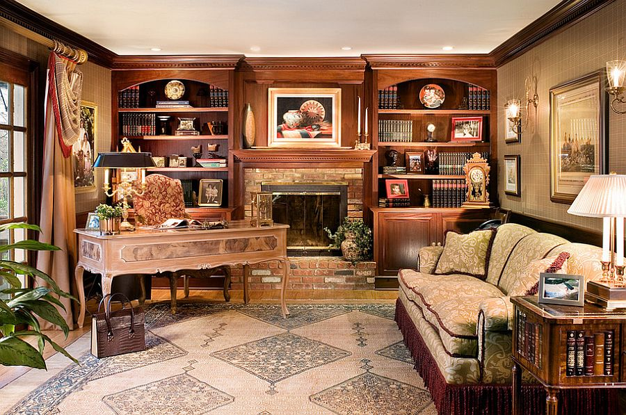 Custom-built bookcases surround the fireplace in this beautiful home office [Design: Marlene Wangenheim]