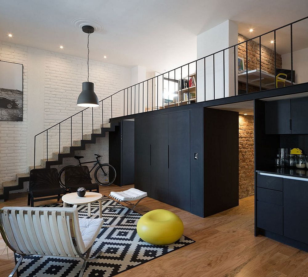 Dark cabinets and kitchen create a striking visual in the living room