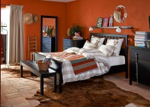 Dark-chest-of-drawers-ground-the-vivacious-bedroom-in-bold-orange-217x155