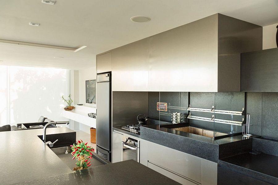 Dark kitchen worktstaion and backsplash in stone