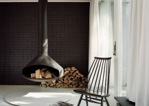 Decorating with firewood around the stunning Fireorb fireplace in black 217x155 Bridging the Present and the Past: Restored 1950s Courtyard House in Berlin