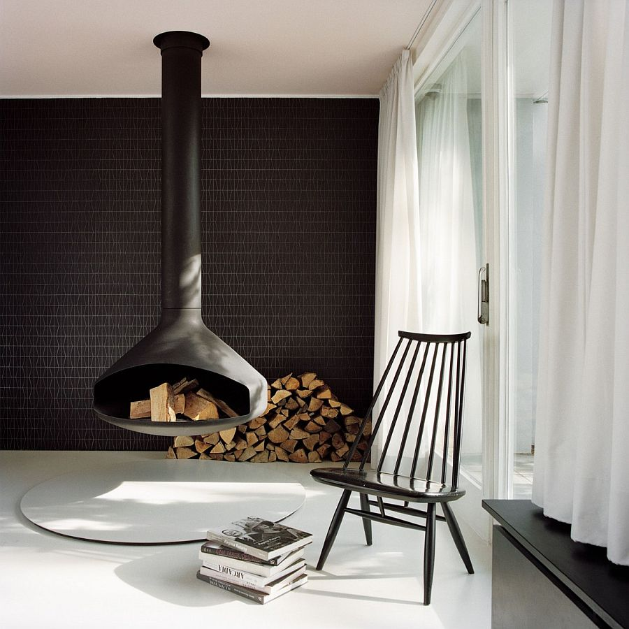 Decorating with firewood around the stunning Fireorb fireplace in black