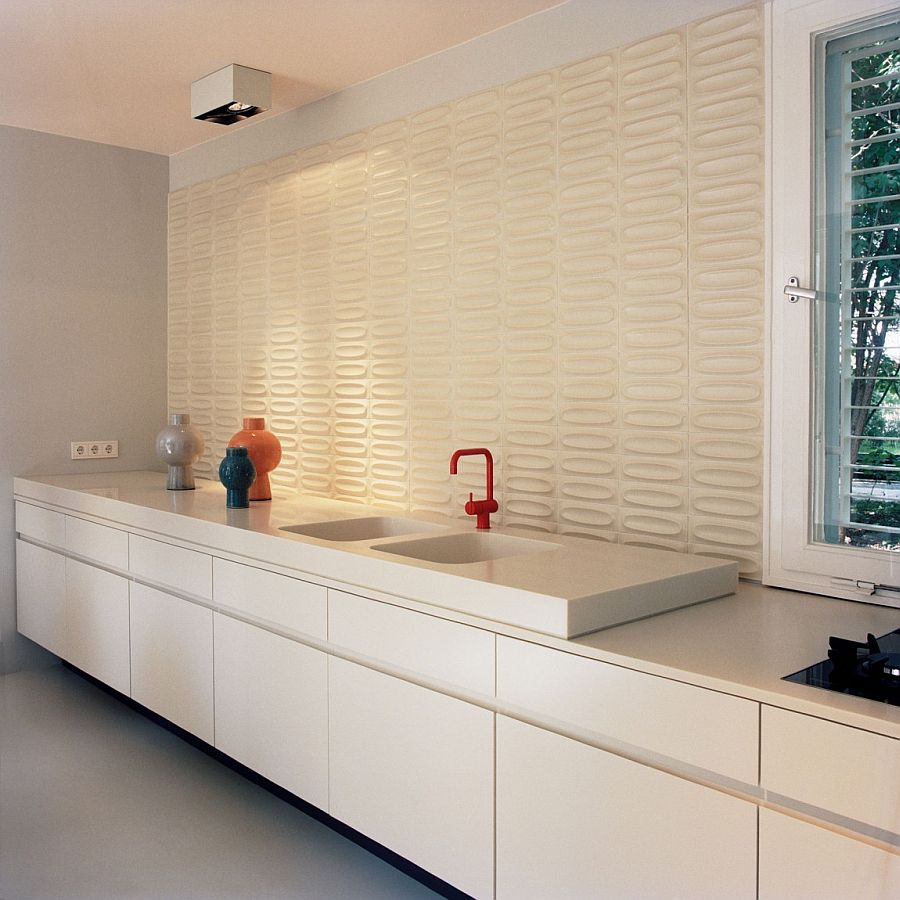 Decorative ceramic tiled backdrop in the contemporary kitchen in white