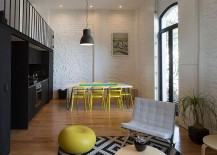 Dining table chairs in yellow and kitchen in black