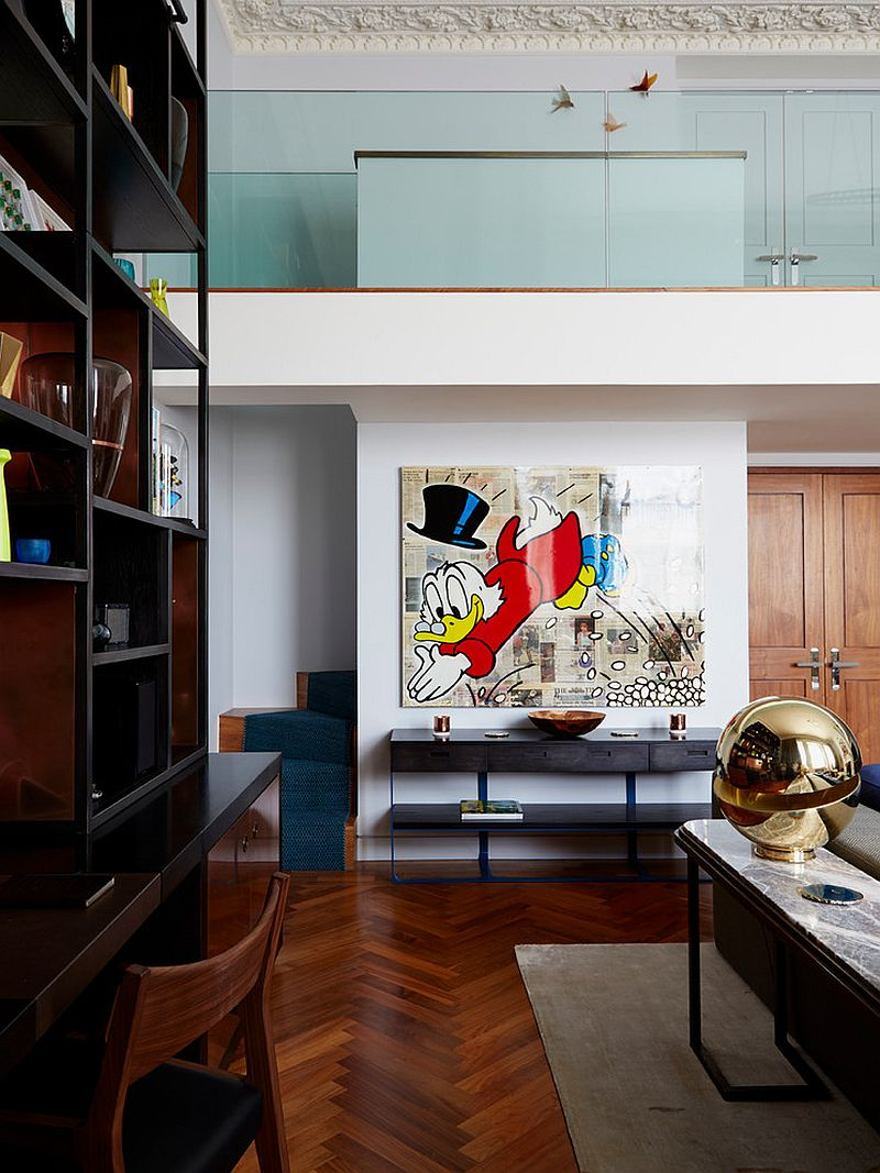 Disney-themed Alec Monopoly painting adds playfulness to the contemporary living room [Design: Violet & George]