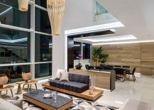 Double height living area with warm wooden tones and geometric style