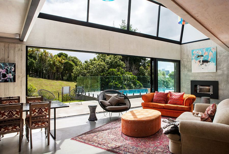 Double height void for the living room with glass windows and doors Industrial Ingenuity: Contemporary Auckland Home in Concrete, Steel and Glass