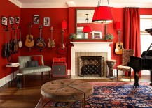 Dramatic-living-room-in-red-with-guitars-on-the-walls-217x155