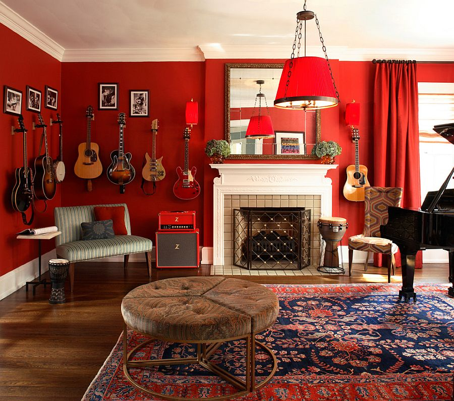 Dramatic living room in red with guitars on the walls [Design: Dillard Pierce Design Associates]