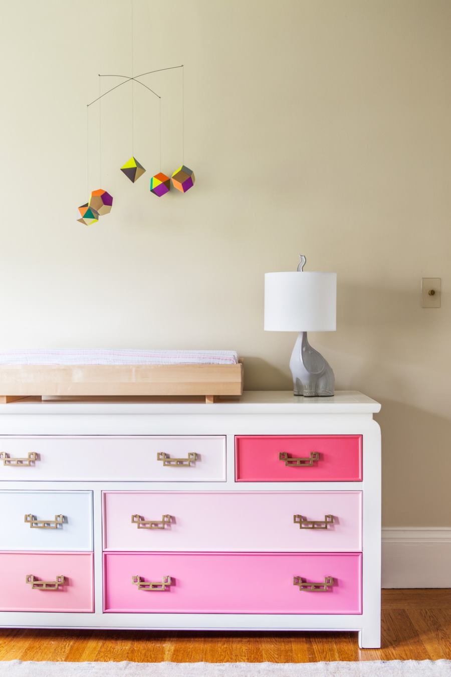Dresser with painted drawer's in a child's bedroom