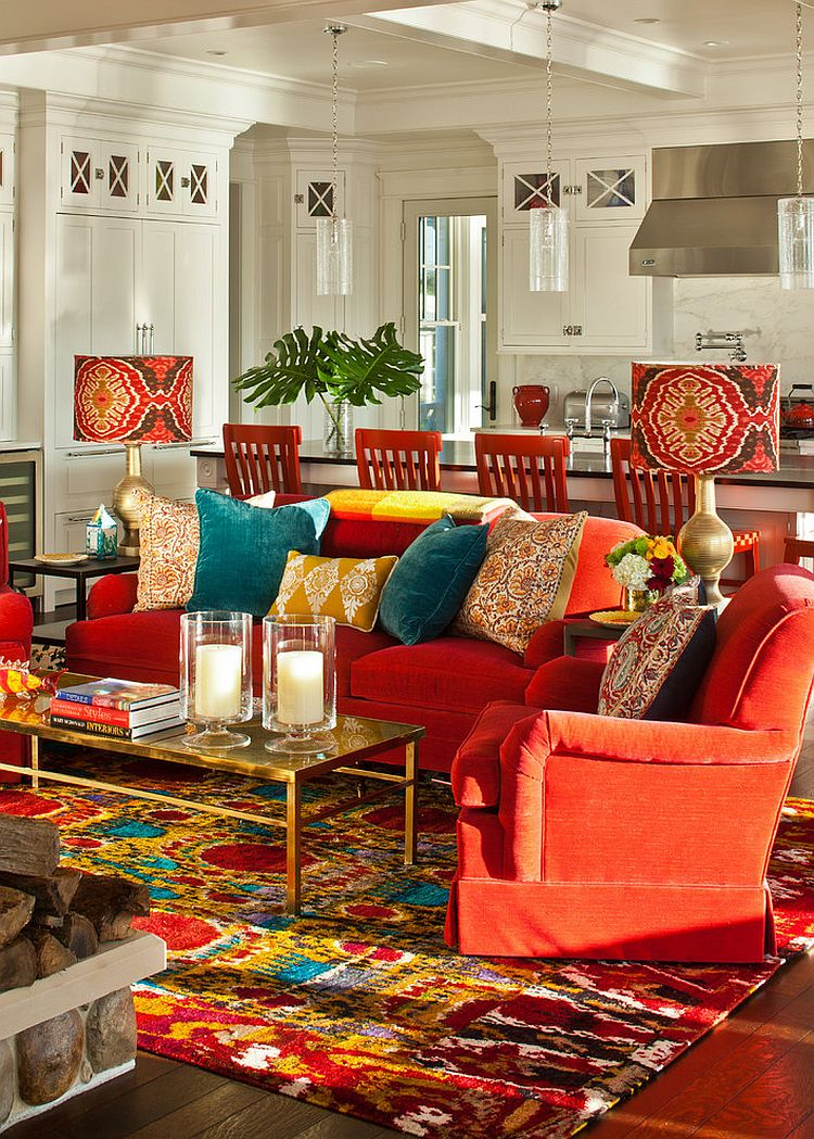 Eclectic living room that celebrates art and color! [Photography: Rikki Snyder]