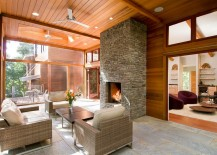 Elegant stone fireplace for the sunroom in wood and glass