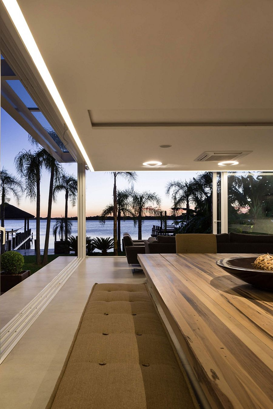 Ergonomic ambient lighting brings warmth to the stylish pool house