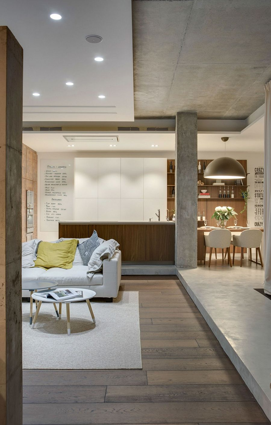 Expoxed concrete gives the Odessa Apartment an industrial touch