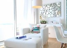 Exquisite decor in white and metallic wall art in the living room