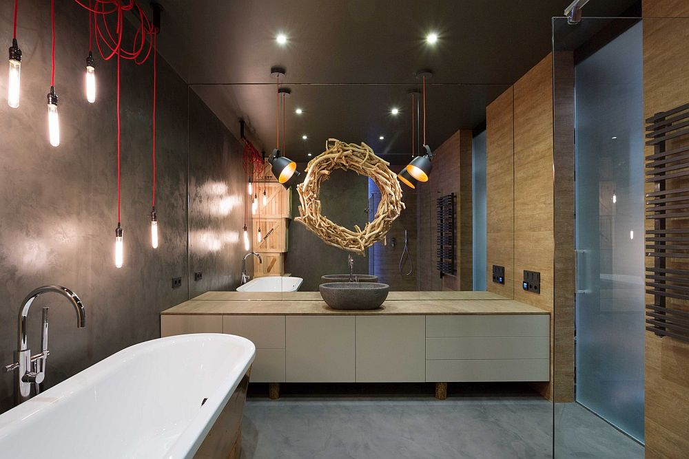 Fabulous industrail styled bathroom with a unique mirror above the vanity