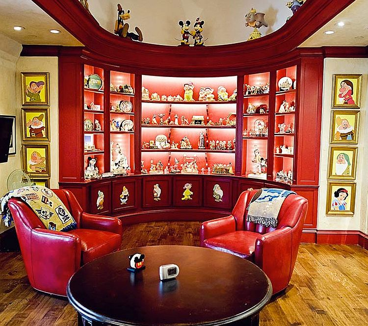 Family room in Dallas home proudly displays Disney Collectibles [Design: Interior Concepts]