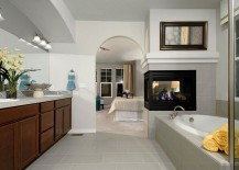 Fireplace-serves-both-the-bedroom-and-the-bathroom-217x155