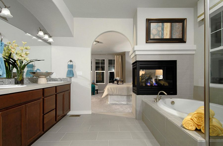 Fireplace serves both the bedroom and the bathroom [Design: Housing & Building Association of Colorado Springs]