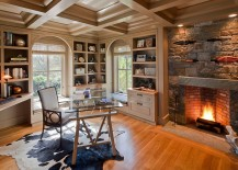 Fireplace surround in Adirondack stone turns it into the focal point of this lovely home office