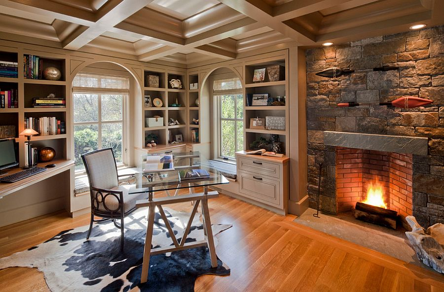 Fireplace surround in Adirondack stone turns it into the focal point of this lovely home office [Design: Polhemus Savery DaSilva]