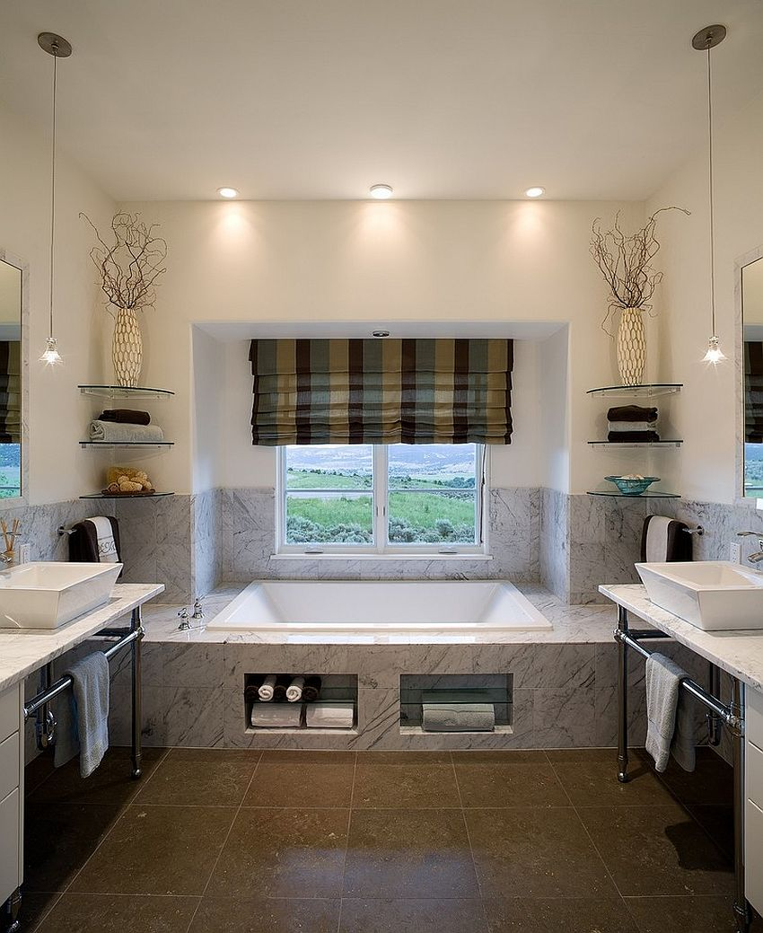 Floating glass shelves bring both aesthetics and functionality to the bathroom [Design: Reed Design Group]