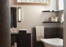 Floating shelves in the corner above the bathtub