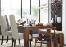 Flowering branches add drama to the dining room