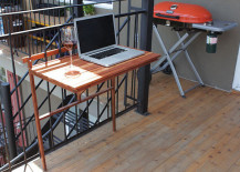 Foldable balcony table used as an outdoor workspace 217x155 Creative Outdoor Accessories to Hang from Your Balcony Railing