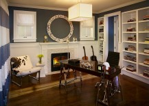 Funky-art-work-above-the-fireplace-replaces-a-traditional-mirror-217x155