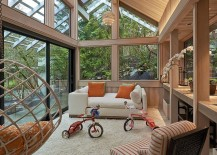 Gabled roof and woodsy warmth greet this contemporary sunroom [Design: Richard Brown Architect]