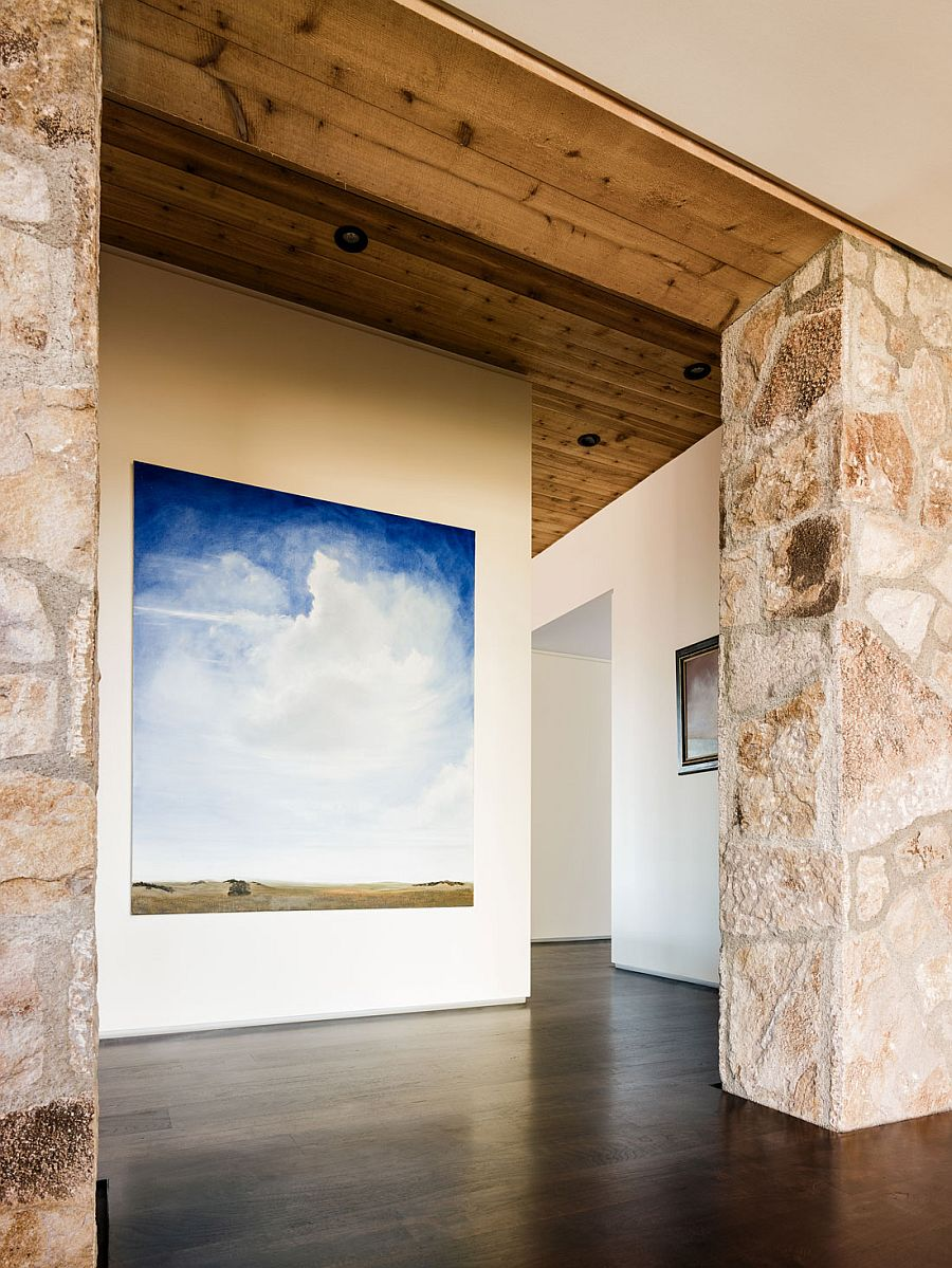 Gallery -styled entrance displays the art collection of the homeowners