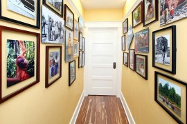 Gallery walls create a beautiful  entry with initing warmth and color