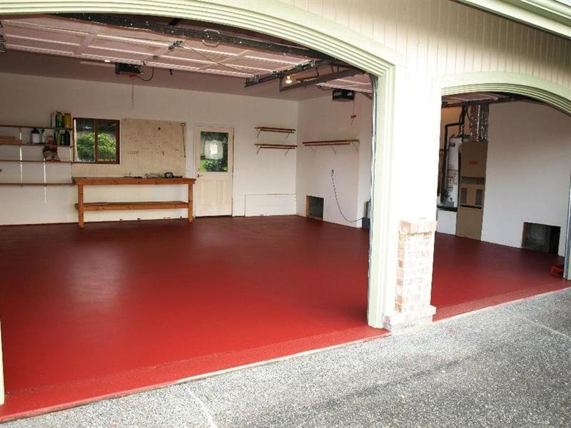Garage with a bold red floor