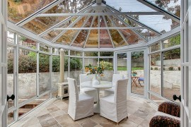 Gazebo-shaped sunroom that is all about glass  50 Bright and Beautiful Contemporary Sunrooms Gazebo shaped sunroom that is all about glass 270x180