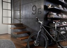 Giant dark cube in the living room made from custom dark concrete panels