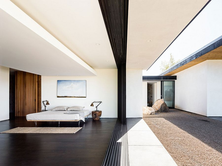 Glass doors bring the outdoors into the bedroom with ease