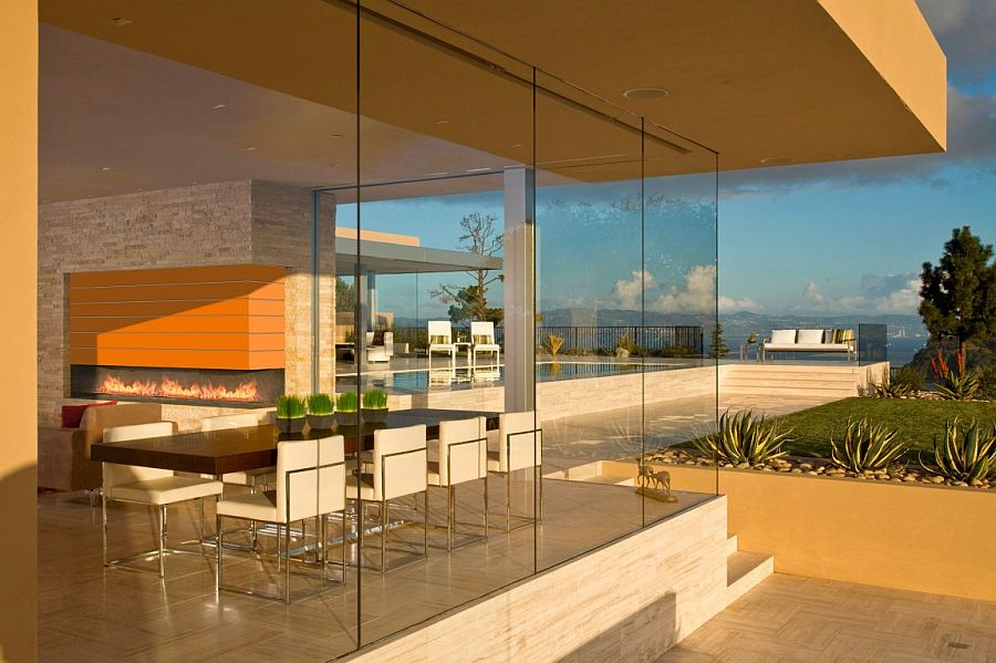 Glass walls offer seamless connectivity with the outdoor spaces