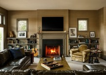 Glow-of-the-fireplace-adds-to-the-aura-of-metallic-coffee-table-217x155