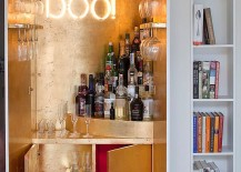 Gold-leaf-sheets-and-illuminated-sign-for-the-wardrobe-home-bar-217x155