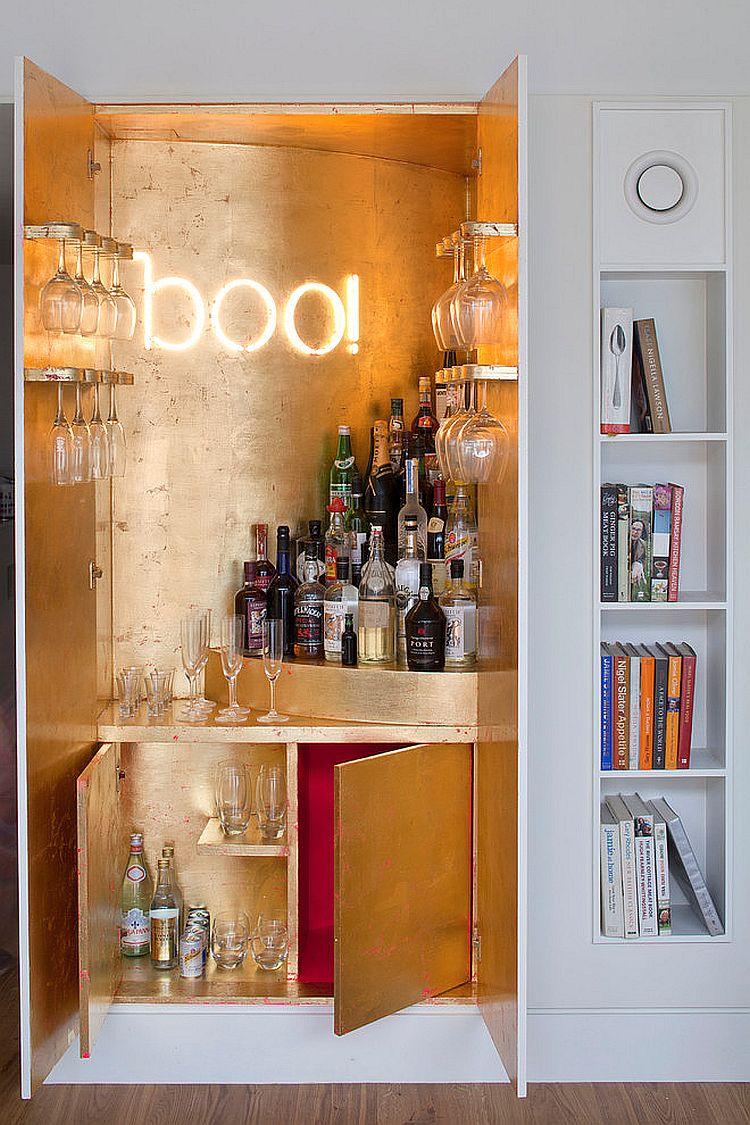 Gold leaf sheets and illuminated sign for the wardrobe home bar [Design: MATT Architecture]