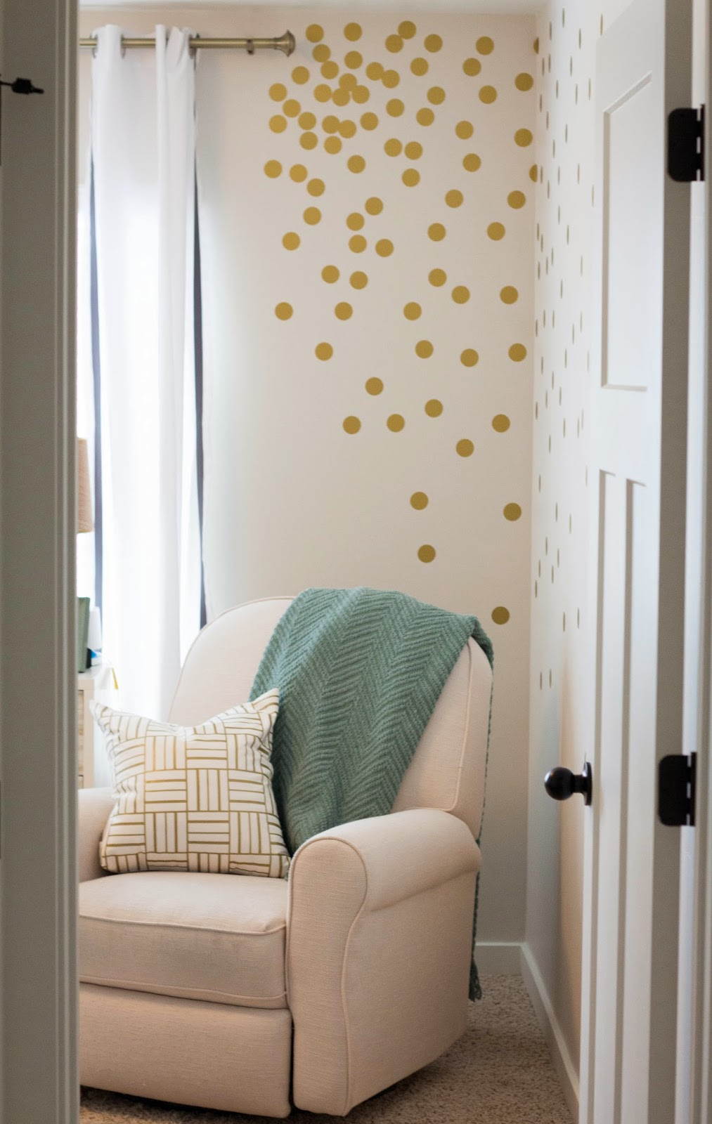 Gold polka dot wall decals in corner