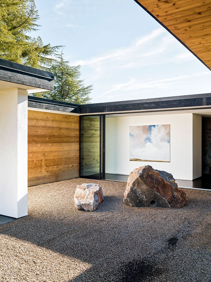 Gravel and stone courtyard next to bedroom