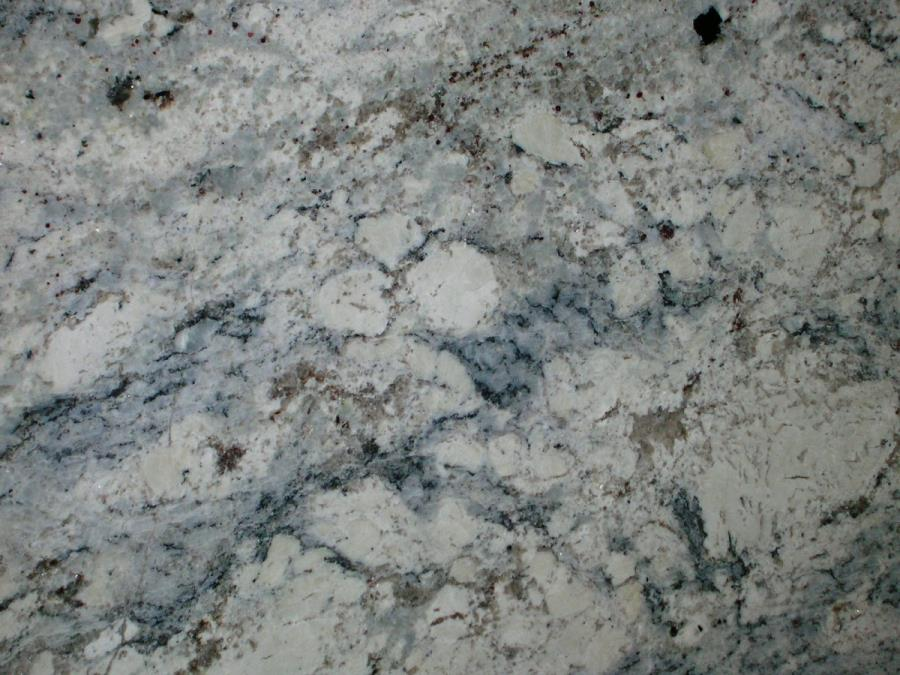Grey and blue veining in a white ice granite slab