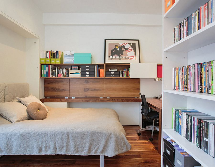 guest bedroom and home office with ample shelf space design raad studio