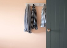 Hanging wall hooks in a peach entryway