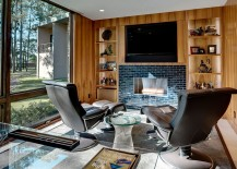 Home office with hidden TV above the fireplace